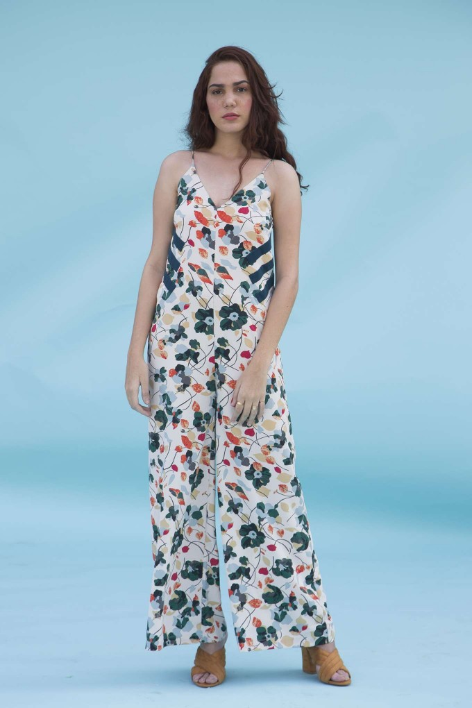 Cream floral jumpsuit with teal green sides