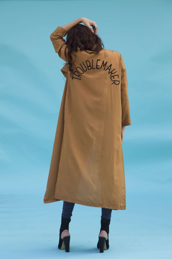 "Brown overcoat with ""Troublemaker"" embroidery"