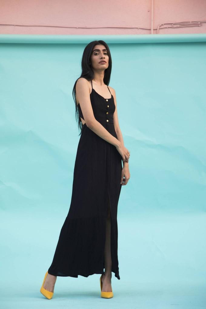 Black crimpled halter neck long dress with gold buttons