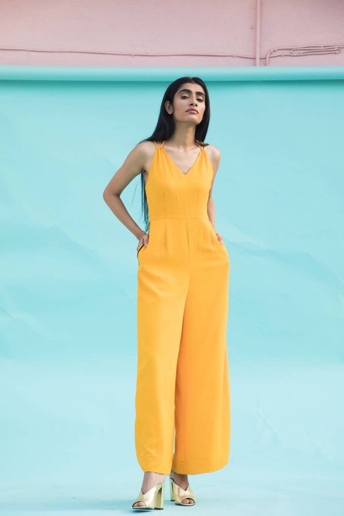 Dark yellow jumpsuit with black tape on sides