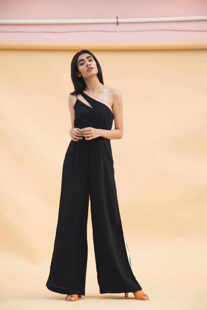 Black jumpsuit with cream tape on sides